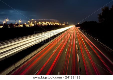 An image of red and white car lights speed lines