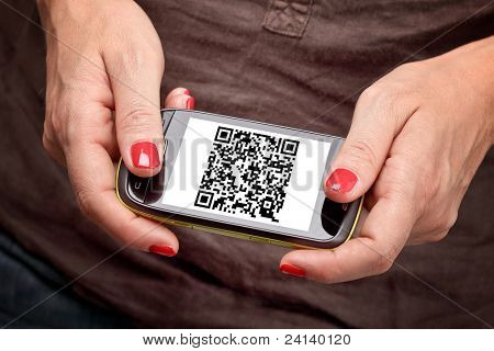 detail on smartphone with qr code on screen