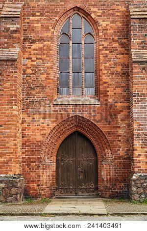 Portal And Wooden Doors Of
