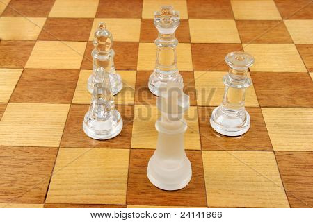Chess Game -  5 Glass Chess Pieces on a wooden chessboard