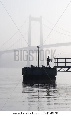Silhouette Of A Man Fishing In Scandinavia