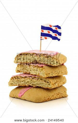 traditional stacked Dutch and Frisian pink glazed pastry called