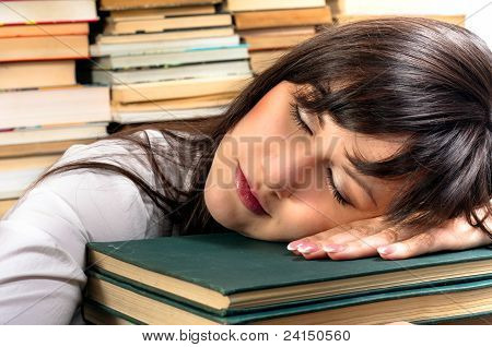 Exhausted Student Girl And Her Books