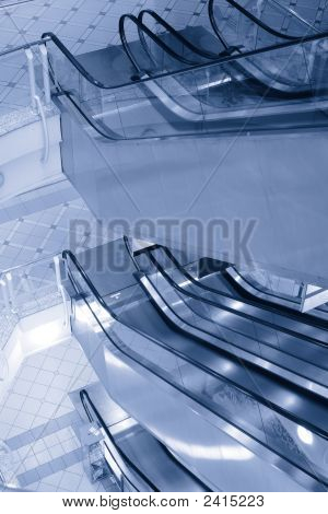 Empty Escalators In The Multilevel Shopping Mall