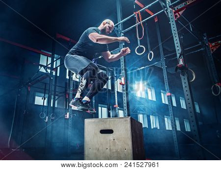 poster of Man Jumping During Exercises In The Fitness Gym. Crossfit Concept. Gym, Sport, Rope, Training, Athle