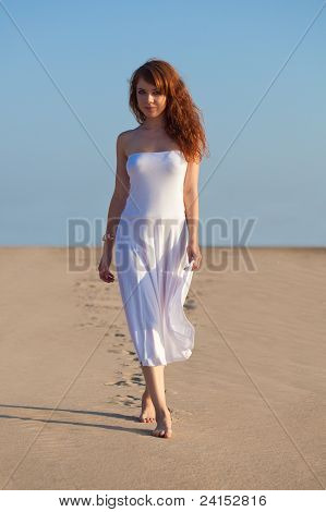 woman walking on sand