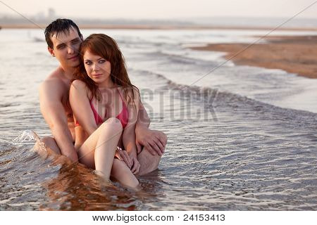 couple sitting in water