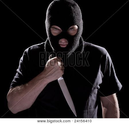 Burglar In Mask Holding Knife