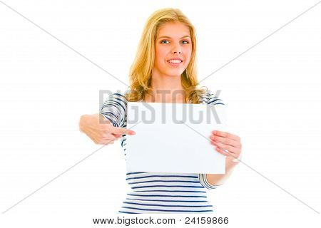Pretty Teen Girl Pointing On Blank Paper Sheet
