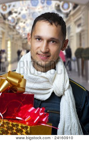 Young Handsome Man With Christmas Gifts