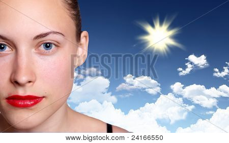Woman against blue sky background