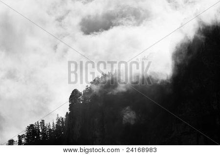 Mountain peak shrouded in clouds