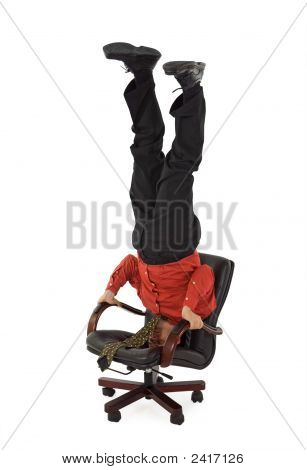 Businessman Relaxing On Office Chair - Unusual Position