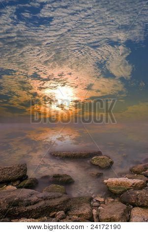 Rocks, sea, sunset