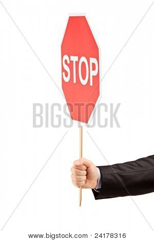 Hand holding a traffic sign stop isolated against white background