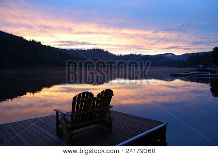 Deck chairs at sunset