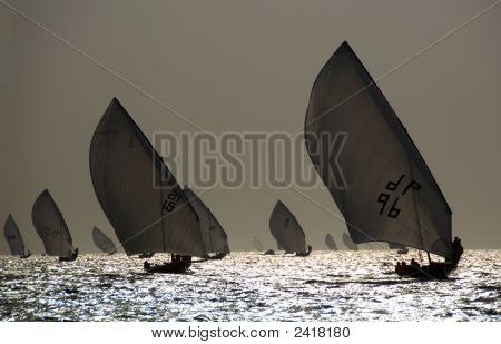 Sailing Dhows Against The Sunset