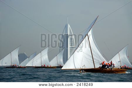 Sailing Dhows Passing Burj Dubai