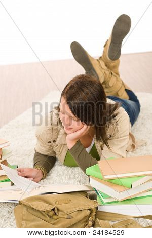 Student Female Teenager Read Homework With Book