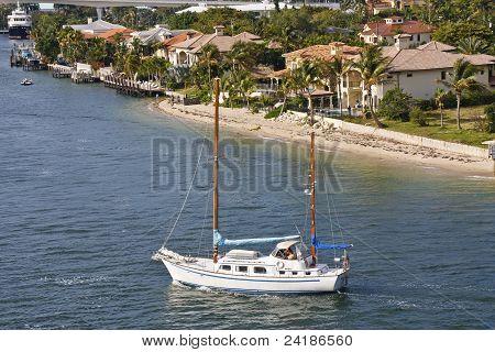 Two Masted Sailboat Sailing Under Motor