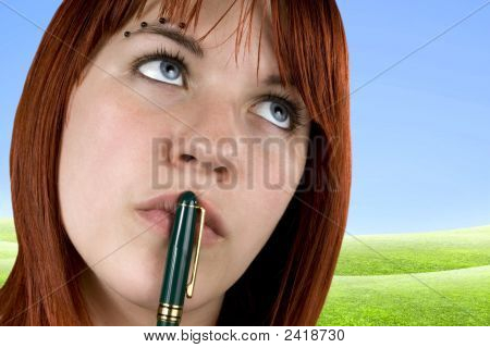 Cute Girl With Pen On Her Lips