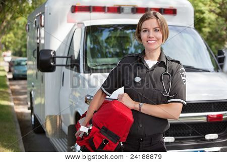 Portrait of a happy paramedica carrying a portable oxygen unit