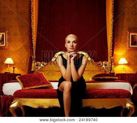 Beautiful woman in luxury interior.