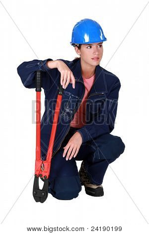 A female manual worker with pliers.