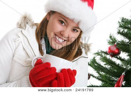 A pretty woman drinking coffee during Christmas