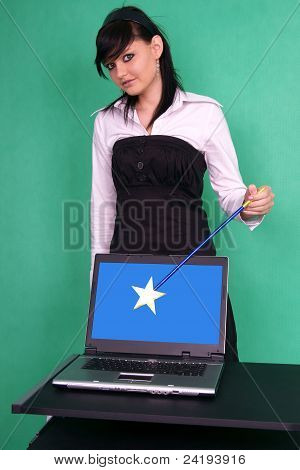 Girl with magic wand and laptop with blank screen.