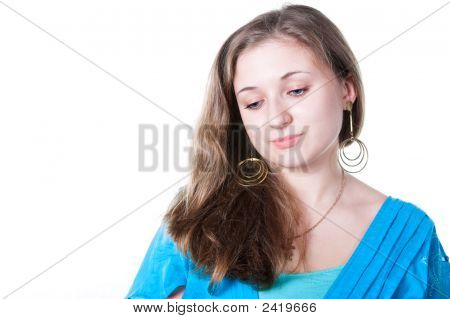 Portrait Of Smiling Beautiful Girl In Blue