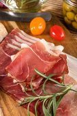 Thinly Sliced German Black Forest Ham. poster