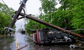 Car Turned Over After Accident With Crash Electric Pole After A Severe Storm poster