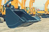 Excavator Bucket Close-up. Heavy Scoop Of A New Excavator poster