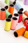 image of lurex  - bobbins of lurex thread - JPG
