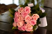 stock photo of wedding table decor  - Bridal bouquet of pink roses on the table - JPG