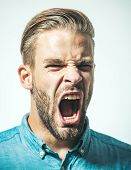 Man With Angry Screaming Face. Portrait Of Angry Screaming Man. Furious Bearded Businessman Shouting poster
