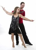 picture of ballroom dancing  - couple dancing salsa in the middle of a pose - JPG