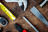 Different Construction Tools With Hand Tools For Home Renovation On Wooden Board Maintenance And Rep poster