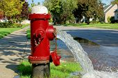 image of gushing  - Open fire hydrant open and gushing water - JPG