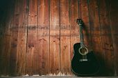 Acoustic Guitar On A Wooden Texture With Copy Space For A Text. Music And Leisure Concept. Guitar Ag poster