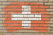 Flag Of Schwitzerland On Grunge Brick Wall Painted With Chalk