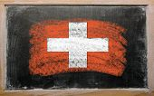 Flag Of Schwitzerland On Blackboard Painted With Chalk
