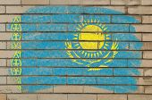 Flag Of Khazakstan On Grunge Brick Wall Painted With Chalk