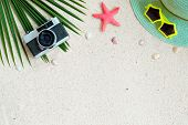 Beach Background.  Top View Of Beach Sand With Coconut Leaves, Camera,  Shells, Starfish, Sunglasses poster