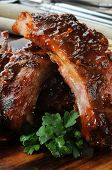 image of baby back ribs  - Macro photo of baby back ribs with barbecue sauce - JPG