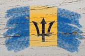 Flag Of Barbados On Grunge Wooden Texture Painted With Chalk