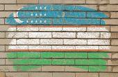 Flag Of Uzbekistan On Grunge Brick Wall Painted With Chalk
