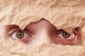 Eye Looking Through Hole In Paper. Spy Eye Watching Through A Hole. Eye Looking Through Hole In Old poster