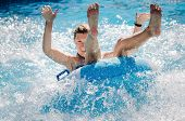 Funny Girl Taking A Fast Water Ride On A Float Splashing Water. Summer Vacation With Water Park Conc poster